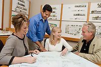 Two women meeting with architect and developer