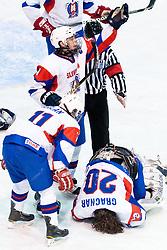 Luka Gracnar of Slovenia injured after being hit by puck in thumb during ice-hockey match between Denmark U18 and Slovenia U18 at IIHF World Championship U18, Division I Group B, on April 15, 2011 at Ledena Dvorana Tabor, Maribor, Slovenia. (Photo By Matic Klansek Velej / Sportida.com)