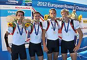 Varese,  ITALY. 2012 FISA European Championships, Lake Varese Regatta Course. ..GBR LM4-  Bow.Sam SCRIMGEOUR, Adam FREEMAN-PASK, William FLETCHER and Jonathan CLEGG, Silver  Medalist Men's Lightweight Four.13:02:50  Sunday  16/09/2012 .....[Mandatory Credit Peter Spurrier:  Intersport Images]  ..2012 European Rowing Championships Rowing, European,  2012 010883.jpg.....