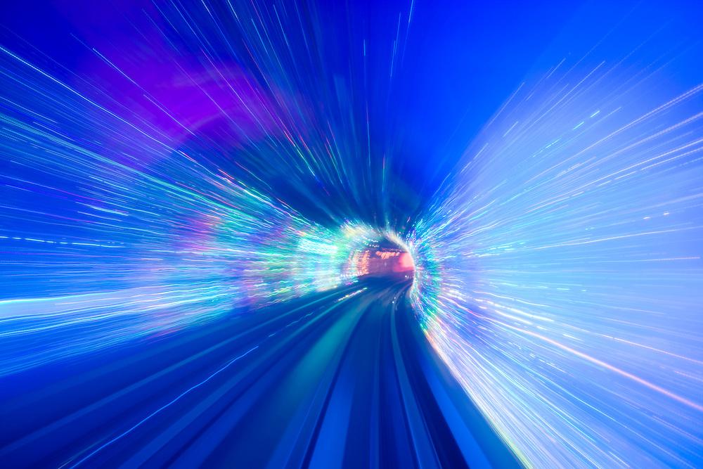Asia, China, Shanghai, Blurred lights along light rail train tracks inside Bund Sightseeing Tunnel that runs under the Huangpu River between Shanghai's Bund riverfront and Pudong New Economic Zone