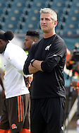 Philadelphia Eagles offensive coordinator Frank Reich watches players warming up before the start of the Eagles - Browns football game September 11, 2016 at Lincoln Financial Field in Philadelphia, Pennsylvania.  (Photo by William Thomas Cain)