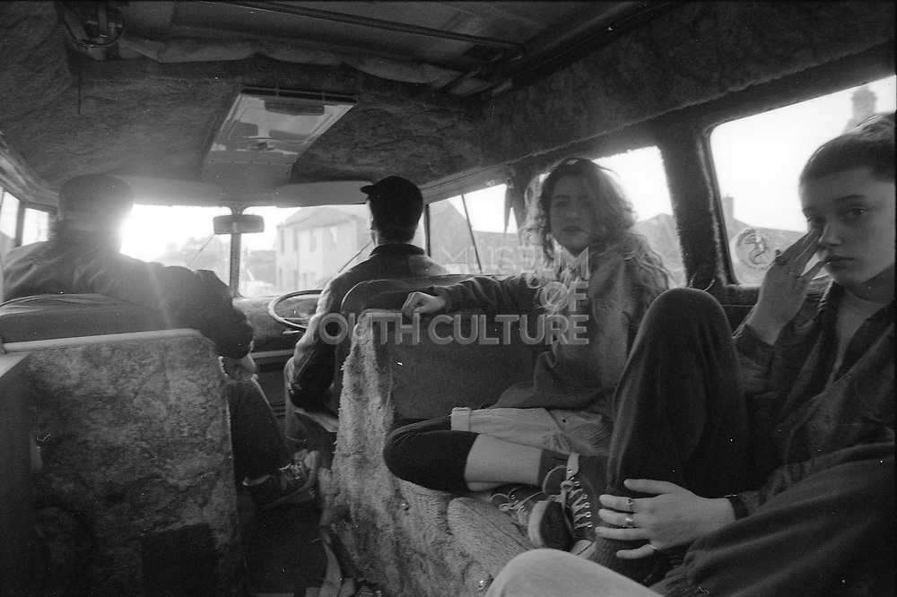 Four people in a camper van, UK, 1990s.