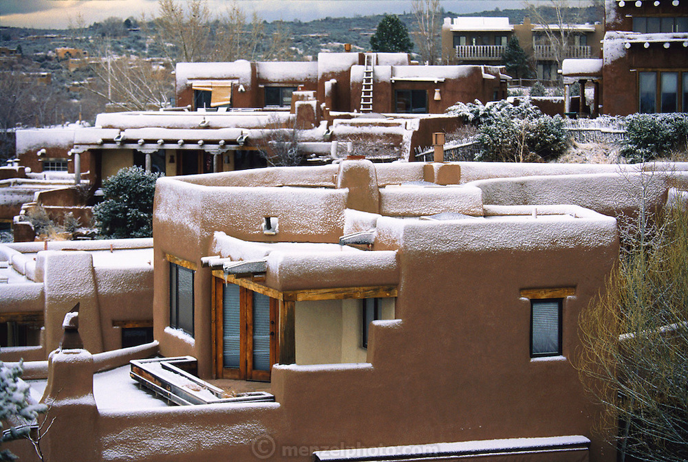 Early March snow dusting the adobe style homes in Santa Fe, New Mexico, USA.