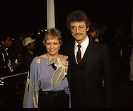 Maureen Reagan and her husband (please check) arriving at a dinner given by 20th Century Fox during the visit of Queen Elizabeth II to California in March 1983...Photograph by Dennis Brack bb23