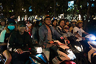 A crowd of motorcyclists waiting for a light to change in Ho Chi MInh City, Vietnam, Southeast Asia