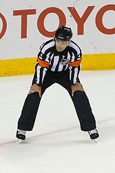 Dec 8, 2011; San Jose, CA, USA; NHL referee Wes McCauley (4) before a face off between the San Jose Sharks and the Dallas Stars during the second period at HP Pavilion.  San Jose defeated Dallas 5-2. Mandatory Credit: Jason O. Watson-US PRESSWIRE