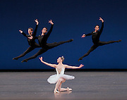 Troy Schumacher, Adrian Danchig-Waring, and Ralph Ippolito with Tiler Peck in.Symphony in C .Choreography George Balanchine .© The George Balanchine Trust.New York City Ballet  .Credit Photo: Paul Kolnik.studio@paulkolnik.com.nyc 212-362-7778
