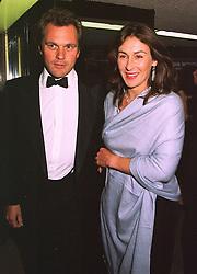 MR & MRS EDWARD HUTLEY she was Lulu Blacker a friend of Prince Charles, at a film premier on 26th August 1998.MJL 28