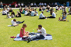 © Licensed to London News Pictures. 25/06/2018. London, UK.  People enjoying the hot and sunny weather at lunchtime near St Paul's Cathedral in London today.  Photo credit: Vickie Flores/LNP