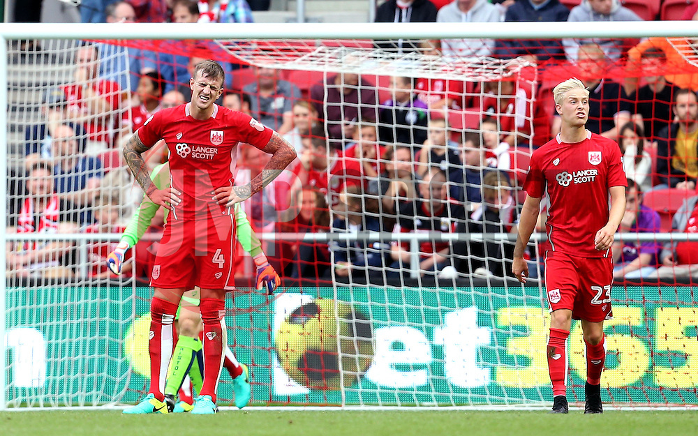 Aden Flint and Hordur Magnusson of Bristol City look frustrated after conceding a goal to Ikechi Anya of Derby County - Mandatory by-line: Robbie Stephenson/JMP - 17/09/2016 - FOOTBALL - Ashton Gate Stadium - Bristol, England - Bristol City v Derby County - Sky Bet Championship