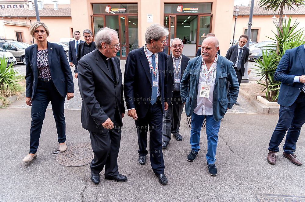 ROME, ITALY - SEPTEMBER 01:  The director of Caritas Rome, Msgr. Enrico Feroci, Italian PM Paolo Gentiloni, New vicar of Rome, Angelo De Donatis, during visit the Citadel of the Charity of the Diocesan Caritas of Rome on September 1, 2017 in Rome, Italy. Italian PM Paolo Gentiloni visited the Caritas to express the gratitude of all Italians to the world of volunteering, to those who work in favour of solidarity.