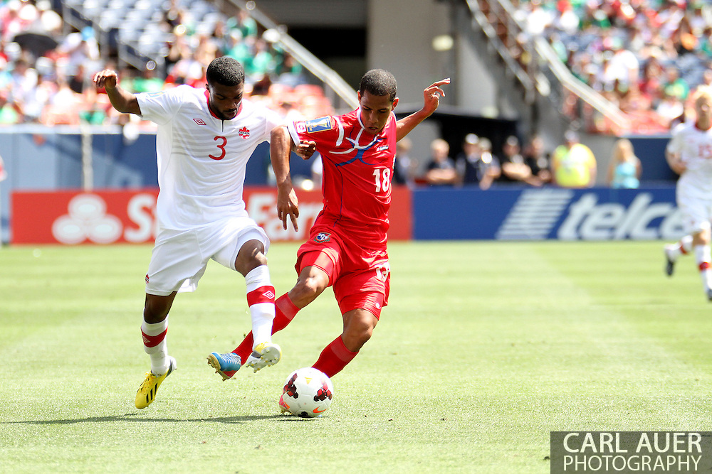 July 14 2013:  Panama Midfield Jairo Jimenez (18) and Canada Defender Ashtone Morgan (3) fight for the ball during the second half of the CONCACAF Gold Cup soccer match between Panama and Canada at Sports Authority Field in Denver, CO. USA.