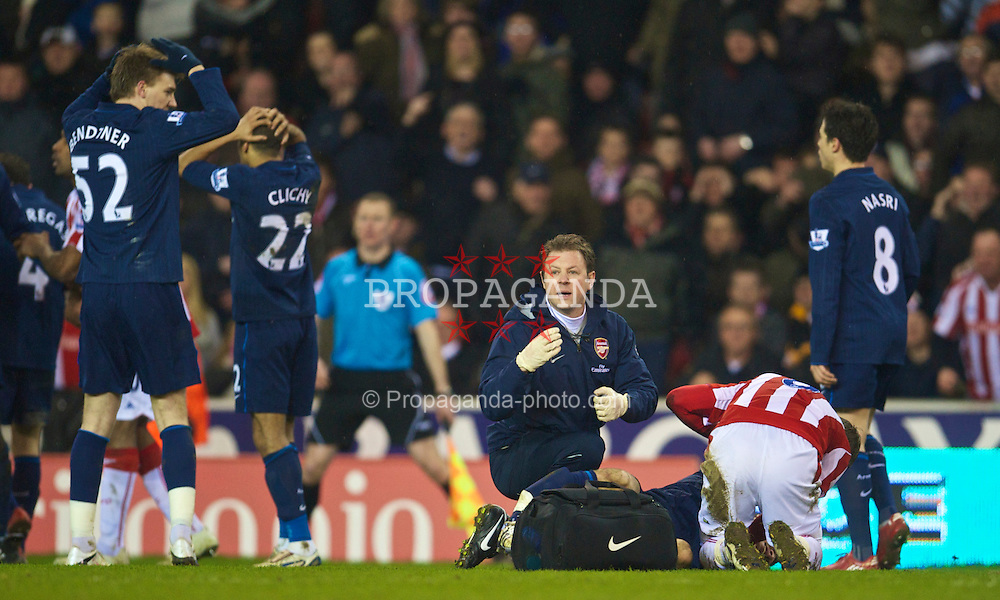 STOKE-ON-TRENT, ENGLAND - Saturday, February 27, 2010: Arsenal's Aaron Ramsey goes down injured as his leg is broken during the FA Premier League match against Stoke City at the Britannia Stadium. (Photo by David Rawcliffe/Propaganda)