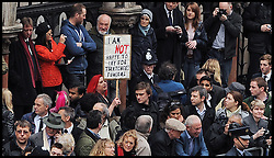 A woman holds a placard 'I am not happy to pay for Thatcher's funeral' during the funeral procession of former British Prime Minister Margaret  Thatcher by the High Court in central London, UK, Wednesday 17 April, 2013, Photo by: Shaun Curry / i-Images