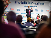 10 AUGUST 2019 - DES MOINES, IOWA: Senator MICHAEL BENNET, (D-CO), a Democratic Presidential candidate, answers questions from gun violence survivors at the Presidential Gun Sense Forum. Several thousand people from as far away as Milwaukee, WI, and Chicago, came to Des Moines Saturday for the Presidential Gun Sense Forum. Most of the Democratic candidates for president attended the event, which was organized by Moms Demand Action, Every Town for Gun Safety, and Students Demand Action.             PHOTO BY JACK KURTZ