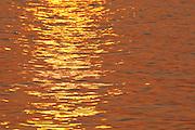 Reflections of sunlight on waters of Pacheca Island shore. Las Perlas Archipelago, Panama province, Panama, Central America.