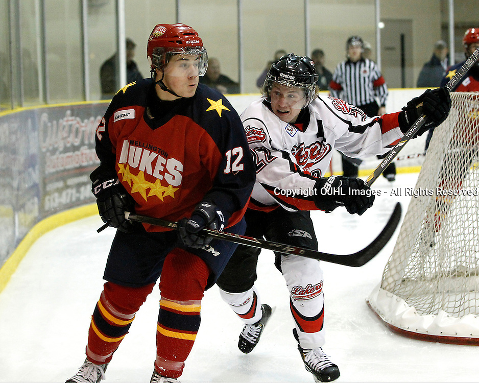 WELLINGTON, ON - Apr 30 : Dudley Hewitt Cup, Central Canadian Jr &quot;A&quot; Championship. Fort Frances Lakers vs Wellington Dukes. Jacob Panetta #12 of the Wellington Dukes is about to get hit by Miles Nolan #27 during second period game action.<br /> (Photo by Tim Bates / OJHL Images)