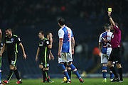 Blackburn Rovers defender, Gordon Greer (3) is shown a yellow card, booked before being shown a is shown a red card, sent off later during the EFL Sky Bet Championship match between Blackburn Rovers and Brighton and Hove Albion at Ewood Park, Blackburn, England on 13 December 2016.