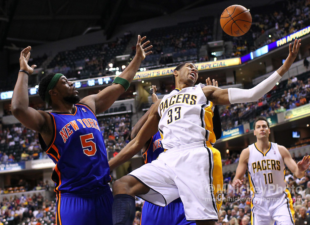 April 10, 2011; Indianapolis, IN, USA; Indiana Pacers forward Danny Granger (33) loses the ball against New York Knicks shooting guard Bill Walker (5) at Conseco Fieldhouse. Mandatory credit: Michael Hickey-US PRESSWIRE