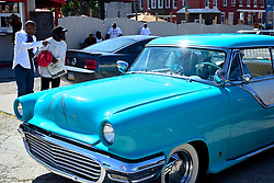 Watched by members of the local classic and American muscle car community Jerome Adams, 69, rolls up in a heirloom from 1951 that he restored, during a community car show in North Philadelphia, on Sunday September 15, 2019.