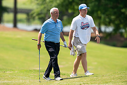 North Carolina head basketball coach Roy Williams walks with a caddy during the 2019 Chick-fil-A Peach Bowl Challenge at the Ritz Carlton Reynolds, Lake Oconee, on Tuesday, April 30, 2019, in Greensboro, GA. (Paul Abell via Abell Images for Chick-fil-A Peach Bowl Challenge)