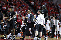 20 March 2017:  Knights celebrate during a College NIT (National Invitational Tournament) 2nd round mens basketball game between the UCF (University of Central Florida) Knights and Illinois State Redbirds in  Redbird Arena, Normal IL<br /> <br /> Asst. Coach Jamill Jones center of photo