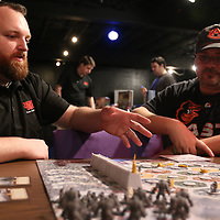 Game Ambassador Dustin Edmonson, left, explains Game of Thrones Catan to Roberth Thornton Saturday at the Tupelo Game Days at the Link Center