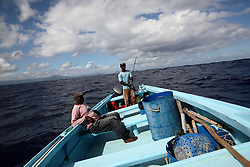 MAURITIUS BLACK RIVER 2MAY13 - Artisanal fishermen Edwin Malgasse and Reneau Parou work in their boat in Black Rivery Bay, Mauritius.<br /> <br /> <br /> <br /> Coastal fishing is in decline due to large, industrial foreign fishing fleets operating in Mauritian waters.<br /> <br /> The Greenpeace ship Esperanza is on patrol in the Indian Ocean documenting fishing activties.<br /> <br /> <br /> <br /> jre/Photo by Jiri Rezac / Greenpeace