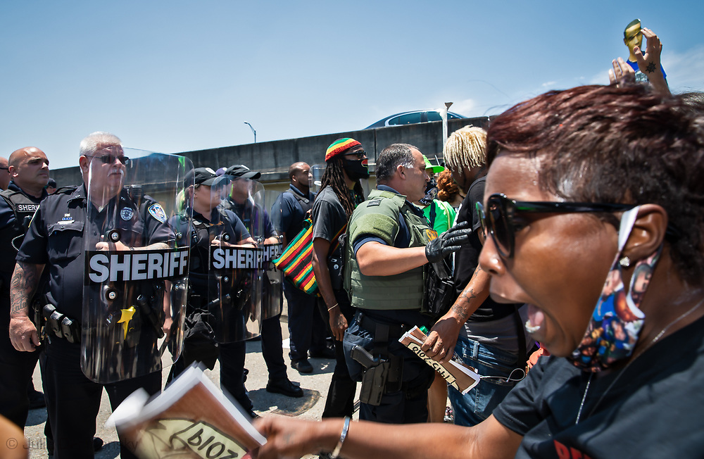 Protesters clash with police on the off ramp of the West Bank Exspressway in Harvey. The protest was organized by families of Modesto Reyes, Keeven Robinson, Darivi Robertson,Chris Joseph, Armond Jairon Brown Eric Harris and Leo Brooks - black men killed by the Jefferson Parish Police since 2018, 5 people were arrested. Family members are calling for accountability from the Jefferson Parish Sheriff's Office and for the officers to be required to wear body cameras. clash with police at tThe protest was organized by the families of Modesto Reyes, Keeven Robinson, Darivi Robertson,Chris Joseph, Armond Jairon Brown Eric Harris and Leo Brooks - black men killed by the Jefferson Parish Police since 2018, 5 people were arrested. Family members are calling for accountability from the Jefferson Parish Sheriff's Office and for the officers to be required to wear body cameras.