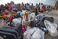 Sabrina Rolle, 34, who's parents home was destroyed, waits with evacuees gathered at Marsh Harbour in Abaco on Friday, September 6, 2019 awaiting to leave the island after Hurricane Dorian swept through the Bahamas.