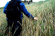 ANCHORAGE, AK - 2009: Photographer and filmmaker Beth Skabar walking on the coast of Anchorage, AK.