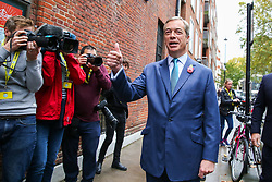 © Licensed to London News Pictures. 01/11/2019. London, UK. Brexit Party leader NIGEL FARAGE arrives at The Emmanuel Centre, Westminster and gives thumbs up to the media. The Brexit Party are launching their election campaign today. Photo credit: Dinendra Haria/LNP