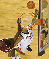 Virginia guard Sylven Landesberg (15) beats the buzzer on a layup at the end of the first half.  The Virginia Cavaliers fell to the Florida State Seminoles 73-62 in NCAA Basketball at the John Paul Jones Arena on the Grounds of the University of Virginia in Charlottesville, VA on January 24, 2009.