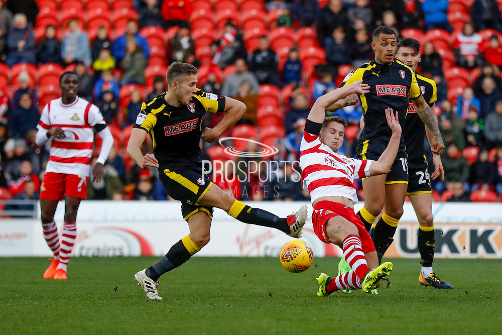 Rotherham United defender Will Vaulks (4) shot blocked by Doncaster Rovers midfielder Jordan Houghton (16), on loan from Chelsea,  during the EFL Sky Bet League 1 match between Doncaster Rovers and Rotherham United at the Keepmoat Stadium, Doncaster, England on 11 November 2017. Photo by Simon Davies.