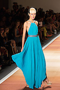 An electric blue floor-length dress with drip hem, gathered halter top and belt.