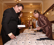 Mark Niccum, visiting from Kernersville, North Carolina (left) helps his girlfriend Josie Olsvig (right) get the programs ready to hand out as guest arrive at The Masterpiece Ball, an evening with the Great Chefs, the 2010 2009 Opera Guild Gala at the Dayton Masonic Center, Saturday, March 13, 2010.