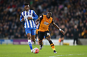 Hull City striker Adama Diomande (25) goes past Brighton central midfielder, Rohan Ince (24) during the The FA Cup match between Hull City and Brighton and Hove Albion at the KC Stadium, Kingston upon Hull, England on 9 January 2016.