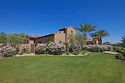 Lawn in backyard of luxury villa