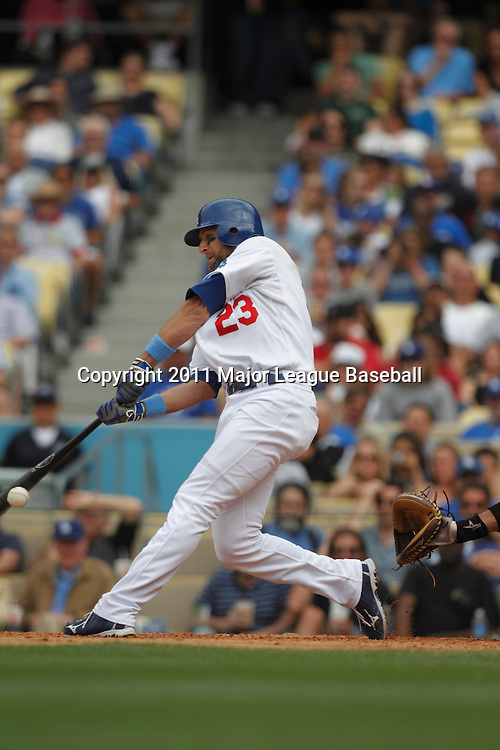 LOS ANGELES - JUNE 19:  Casey Blake #23 of the Los Angeles Dodgers hits into an inning ending double play with runners on base during the game against the Houston Astros at Dodger Stadium on Sunday, June 19, 2011 in Los Angeles, California.  The Dodgers defeated the Astros 1-0.  (Photo by Paul Spinelli/MLB Photos via Getty Images) *** Local Caption *** Casey Blake