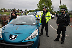© Licensed to London News Pictures . 18/05/2019. Oldham, UK. A car with a smashed windscreen , damaged as bricks and bottles were thrown . Former EDL leader Stephen Yaxley-Lennon (aka Tommy Robinson ) continues his campaign for a seat in the European Parliament representing the North West of England , by visiting Oldham . Photo credit: Joel Goodman/LNP