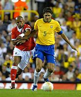 Photo: Ed Godden.<br /> Brazil v Wales. International Friendly. 05/09/2006.<br /> Wales's Robert Earnshaw (L) is held off the ball by Brazil Captain Edmilson.