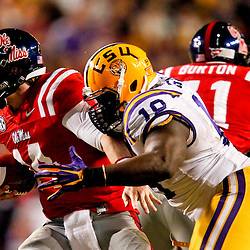 November 17, 2012; Baton Rouge, LA, USA  LSU Tigers defensive tackle Bennie Logan (18) sacks Ole Miss Rebels quarterback Bo Wallace (14) during a game at Tiger Stadium. LSU defeated Ole Miss 41-35. Mandatory Credit: Derick E. Hingle-US PRESSWIRE