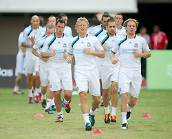 SINGAPORE, SINGAPORE - Sunday, July 17, 2011: Liverpool's Jamie Carragher, Dirk Kuyt, Joe Cole and Christian Poulsen during an exhibition training session at the Bishan Stadium in Singapore on day seven of the club's preseason Asia Tour. (Photo by David Rawcliffe/Propaganda)