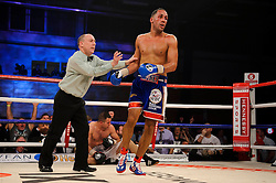 James DeGale (blue shorts) is pushed away by the referee after winning with an 11th round stoppage over Gevorg Khatchikian (white shorts) to defend his WBC Silver super middleweight title<br /> - Photo mandatory by-line: Rogan Thomson/JMP - Tel: 07966 386802 - 01/03/2014 - SPORT - BOXING - The City Academy, Bristol - James DeGale v Gevorg Khatchikian.