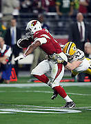 Arizona Cardinals rookie running back David Johnson (31) tries to avoid a tackle attempt by Green Bay Packers rookie inside linebacker Jake Ryan (47) on a first quarter pass reception during the NFL NFC Divisional round playoff football game against the Green Bay Packers on Saturday, Jan. 16, 2016 in Glendale, Ariz. The Cardinals won the game in overtime 26-20. (©Paul Anthony Spinelli)