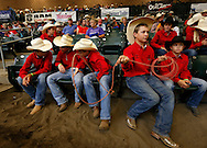 Rowdy Jones, 13, of Tupelo, Okla., spins his lasso as he sits in the stands with members of his junior high rodeo team from Oklahoma Wednesday, June 24, 2015, during the National Junior High Finals Rodeo at the Iowa State Fair Grounds in Des Moines, Iowa.