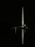 Washington Monument and US Capitol as reflected in the Reflecting Pool in Washington, DC. Nice illumination and reflection at nighttime!