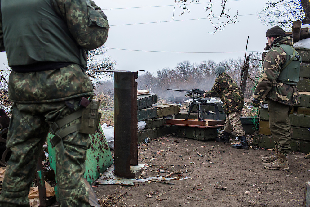 PIKSY, UKRAINE - NOVEMBER 19, 2014: Members of the Dnipro-1 brigade, a pro-Ukraine militia, fire toward areas controlled by pro-Russian rebels in Pisky, Ukraine. The village of Pisky is the scene of much of the front-line fighting over the Donetsk airport. CREDIT: Brendan Hoffman for The New York Times