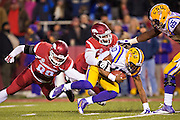 FAYETTEVILLE, AR - NOVEMBER 15:  Anthony Jennings #10 of the LSU is sacked by Deatrich Wise Jr. #43 of the Arkansas Razorbacks at Razorback Stadium on November 15, 2014 in Fayetteville, Arkansas.  The Razorbacks defeated the Tigers 17-0.  (Photo by Wesley Hitt/Getty Images) *** Local Caption *** Anthony Jennings; Deatrich Wise Jr.