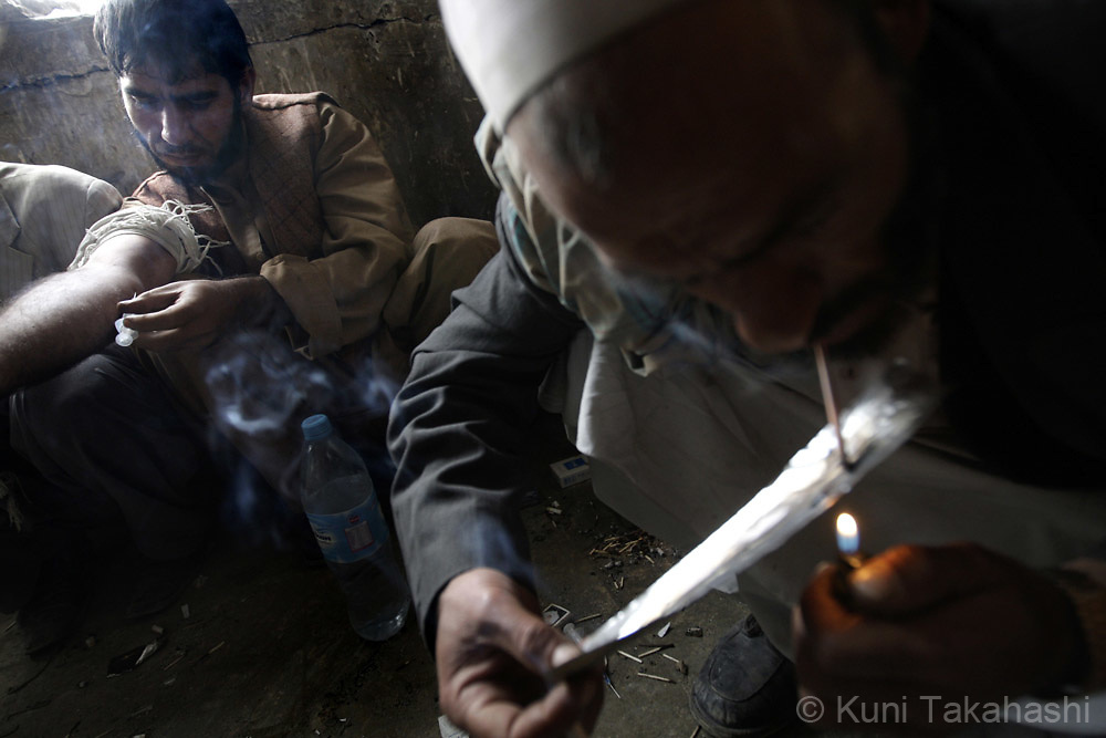 Men smoke and inject heroin in an abandoned building in Kabul, Afghanistan on Nov 14, 2008. According to the United Nations, illegal drug addiction rates in Afghanistan have doubled in the past two years.